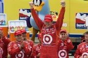 Winner Scott Dixon celebrates his victory in the Road Runner Turbo Indy 300 on Sunday at Kansas Speedway.