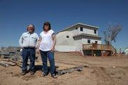 Jill and Scott Eller in front of their split-geodesic dome home in Greensburg, Kansas. Thursday 23 April 2009