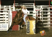 Jessa Perry, of Longford, along with her horse, Shadow, compete in the barrel racing competition at a rodeo in Salina in 2007. Perry, a Baker University student, has been participating in rodeos since age 3.