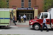 An empty stretcher is brought out of Naismith Hall as Lawrence Douglas County Fire & Medical respond to a report of a man found dead at Naismith Hall Friday morning. No foul play is suspected.