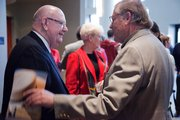 Kansas University chancellor Robert Hemenway, left, receives a handshake from Bill Myers at the goodbye event Saturday at the Lied Center celebrating the chancellor's 14 years of leadership.