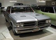 a 1964 Pontiac GTO is shown Sept. 10, 2008, at the General Motors Heritage Center in Sterling Heights, Mich. General Motors announced it is killing off Pontiac, the maker of impressively big and noisy cars that, when it came to being immortalized in song and movies, once outdid everybody else.