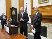 Gov. Mark Parkinson, left, and Earl Watkins, president and chief executive officer of Sunflower Electric Power Corp. share a laugh during a news conference Monday announcing a proposed agreement that will allow Sunflower Electric to build an 895-megawatt coal-burning power plant in southwest Kansas.