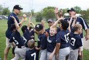 Rays team members, all 7 years old, celebrate after a win at YSI fields.