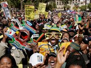 People react after the swearing in ceremony for South African President Jacob Zuma on Saturday in Pretoria, South Africa. Zuma took the presidential oath to become leader of the continent's economic powerhouse after overcoming corruption and sex scandals and a struggle for control of his party.
