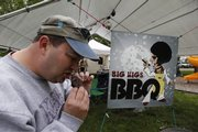 Patron Brian Alton samples ribs from Big Wigs BBQ of Olathe.