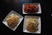 Some of the French fries at The Burger Stand at Dempsey's: Sweet potato fries, duck-fat fries and truffle fries.