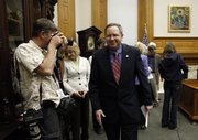 Gov. Mark Parkinson's chief of staff Troy Findley leaves a news conference after the announcement that he will be the new lieutenant governor Thursday in Gov. Parkinson's ceremonial office at the Kansas Statehouse.