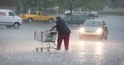 A shopper at Hy-Vee, 3504 Clinton Pkwy., rushes for her car as heavy rain fell in Lawrence on Friday, May 15, 2009 around 4:30 p.m.