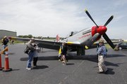 A vintage P-51 Mustang airplane draws a crowd of aviation history buffs during the celebration of the Lawrence Municipal Airport's 80th anniversary on Saturday, May 16, 2009.