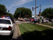 Emergency crews respond at the scene of an accident at the intersection of 11th and Kentucky streets Monday afternoon.
