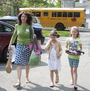Connie Marsala of Ridgefield, Conn., runs errands with her daughters, Sophie Reale, 7, and Lily Reale, 8. Getting ready for day camps requires plenty of advanced planning for parents, like Marsala, who must plan their schedules around camp hours.