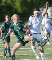 Free State soccer player Erin Ice battles Lawrence High player Regan Keller to get possession of the ball in the Lions 2-0 6A Regional win against the Firebirds at Lawrence High school Tuesday, May 19, 2009.