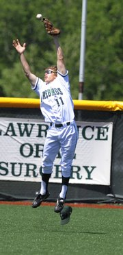Nick Hassig tries to make a play in the fifth inning as a hard-hit ball rolls out of his glove. Free State got by Junction City in the first round of 6A State Regional play on Wednesday.