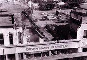 Workers demolish Downtown Furniture in this September 29, 1967 photograph.