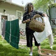 "Randi Hacker, Lawrence, lets the sunshine and wind dry her laundry. Hacker is the author of the book ""How to Live Green, Cheap and Happy."""