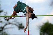 Free State junior Drue Davis clears the bar at 11-feet, setting a new school record during 6A regional track at Shawnee Mission North Friday.