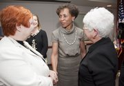 Bernadette Gray-Little, center, named as Kansas University&#39;s 17th chancellor Friday, May 29, 2009, greets Barbara Atkinson, Executive Vice Chancellor of the University of Kansas Medical, left and 10th Circut Judge Deanell Reece Tacha, right. Gray-Little is provost and executive vice chancellor at the University of North Carolina-Chapel Hill. She is a former psychology professor who served as dean of UNC&#39;s College of Arts and Sciences before being named provost.