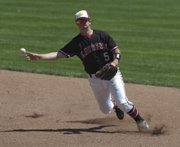 Lawrence High's Devin Forio hurls the ball to first base for an out in the bottom of the sixth inning against Goddard. Lawrence won, 4-1, on Saturday, May 30, 2009 at the 3&2 Baseball Complex in Lenexa.