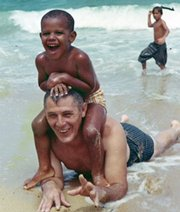 This photo, provided by the presidential campaign of Sen. Barack Obama, D-Ill., shows WWII veteran Stanley Armour Dunham playing with his grandson Barack Obama.