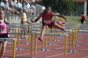 Whitney Dembe jumps the hurdles at the 2009 state track meet in Wichita.