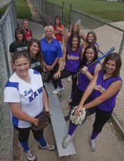 Pictured at the Hobbs Park Softball diamond are the members of this year's All-Area Softball Team. Surrounding coach Jill Larson-Bradney of Perry-Lecompton are, clockwise from front left: Courtney Kasson, Perry-Lecompton; Rosie Hull and Maggie Hull, Free State; Hailie Rae, Ottawa; Lauren Himpel, Tonganoxie; Alex Zordel, Baldwin; and Kendall Patterson, Missy Rome, Lezley Lawson and Kaley Patterson, McLouth.