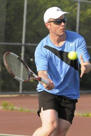Steve Martin, of Ottawa, competes in a men's 4.0 singles match Friday, June 5, 2009 at the Lawrence Tennis Center.