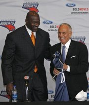 Michael Jordan presents a jersey to introduce Larry Brown as coach in this April 29, 2008, file photo in Charlotte, N.C. Brown expressed concern in Jordan's recent unknown role with the franchise.