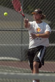 Action continued Saturday in the Lawrence Open tennis tournament. Derek Gillilan of Higginsville, Mo., returns the ball in quarterfinals men's open.
