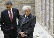"President Barack Obama and Buchenwald survivor Elie Wiesel visit the memorial site for the ""Kleines Lager"" (Little Camp) on Friday inside the Buchenwald concentration camp near Weimar, Germany."
