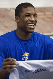Kansas freshman Thomas Robinson came to campus early and made a public appearance at Bill Self's summer basketball camp.