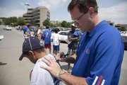 Sunday was the first day of the Bill Self Basketball Camp and one of the first thing campers got to do was get some autographs from KU players. KU Coach Bill Self was signing autographs in the parking lot including this tee shirt for Kreegen Nelson of Wichita.