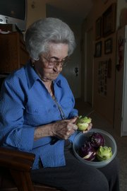 Native Hungarian Mary Czupor grew up eating kohlrabi, a sweet vegetable.