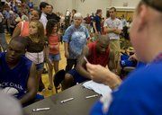 Former KU basketball players Russell Robinson and Darnell Jackson sign autographs after the Rock Chalk Roundball Classic on Thursday, June 11, 2009 at Free State.