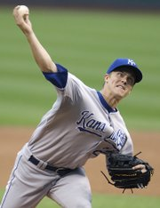 Kansas City Royals pitcher Zack Greinke delivers to Cleveland Indians' Mark DeRosa in the first inning. The Royals lost, 4-3 in 10 innings, Thursday in Cleveland.
