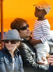 Madonna and her son David Banda along with photographer Stephen Klein watch the Veuve Clicquot Manhattan Polo Classic on May 30 in New York. Madonna can adopt a second child from Malawi, the southern African country's highest court ruled Friday.