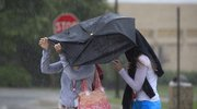 Many in Lawrence were caught up in Monday morning's brief, but heavy, rainfall, about 8 a.m. Students in summer school at Kansas University were looking for anywhere to hide from the torrential rains.