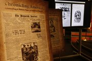 Both printed and digitized copies of historic newspapers are seen on display Tuesday at the Newseum in Washington.