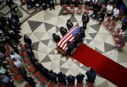U.S. honor guards carry the coffin of Sgt. Jasper Obakrairur, 26, of Palau, during a funeral ceremony Tuesday at the Palau Capital building in Melekeok. Obakrairur is the first Palauan to be killed in Afghanistan under Operation Enduring Freedom.
