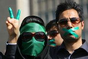 Supporters of opposition leader Mir Hossein Mousavi listen to his speech at a demonstration Thursday in Tehran.