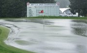 Water floods the 18th green at the Bethpage State Park's Black Course on Thursday in Farmingdale, N.Y. Play was halted during the first round of the U.S. Open and will resume today.