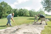 Groundkeepers Gordy Lowe, left, James Tonner, right, and Zach Woodrow at work at Deer Creek state park golf course May 29 in Mount Sterling, Ohio. Despite strict limits on adding new employees imposed last year, Ohio still hired 17 administrators earning six-figure salaries, two workers for state park golf courses and a prison chaplain, records show. The golf course workers were hired for state-run courses at Deer Creek State Park south of Columbus and Shawnee State Park in southern Ohio. The state's six golf courses bring in nearly $2 million a year in greens fees, and these workers are critical to maintaining that revenue stream, said Natural Resources spokeswoman Beth Ruth.