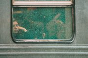 A subway rider looks through a window during heavy rainfall Thursday in Brooklyn, New York City. Forecasters at the National Weather Service warned that up to 2 inches of rain could fall Thursday.