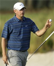 Lucas Glover waves his ball after his putt on the 16th green during the second round of the U.S. Open on Friday in Farmingdale, N.Y. Glover is the early leader through part of the second round. Story on page 8C.