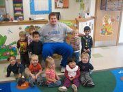 Kansas offensive lineman Brad Thorson poses for a photo during the Jayhawks' READ event at Hilltop Child Development Center. Student-athletes make numerous visits to local elementary schools throughout the year to read to young students.