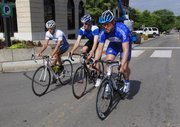From Left, Adam Mills, 29, Channel 6 reporter Mark Boyle and Dan Hughes, 40, practice cycling sprints through downtown Lawrence. Bicycle enthusiasts will be hitting Lawrence on the July 4 weekend for the 2009 Tour of Lawrence bike races.