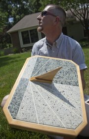 Michael Eravi designs and makes sundials in addition to having a home repair business.