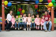 """The Gosselin family poses at a party to celebrate the sextuplets' 5th birthday in this photo released by TLC. Mom Kate is at left and dad Jon on the far right. Some fans of """"Jon & Kate Plus 8"""" say with the couple divorcing, it's time to end the show."""