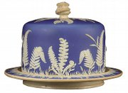 This jasperware-covered dish is 12 1/2 inches in diameter. The fern and cattail decoration was used on similar dishes made by Dudson Pottery, makers of pottery in England since about 1900. The dish sold for $153 at Jacksons Auctioneers of Cedar Falls, Iowa.