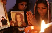 Christian girls who are fans of Michael Jackson take part in a candlelight memorial to commemorate him Friday in Karachi, Pakistan. Michael Jackson was due to make his triumphant return to the stage in London next month but instead his sudden death has left millions of fans feeling they've lost a lifelong friend.